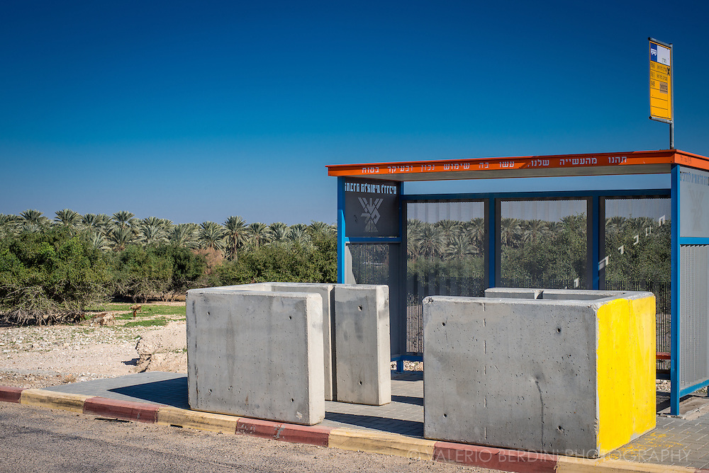 A bus stop along route 90, a West Bank Area C zone. Accessed to both Israeli and Palestinian citizens, the big concrete blocks are put in place by Israeli police to deter Arab terrorist from driving into Jewish people waiting for a bus.