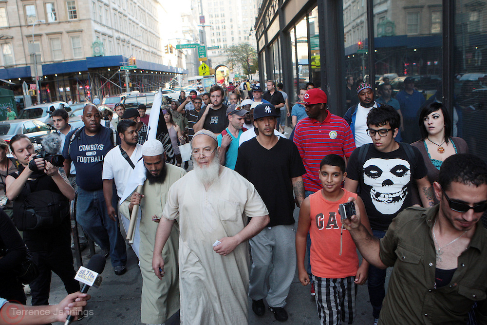11 September 2010- New York, NY- Muslims walk and expouse tenements of Islam at the protests of the construction of the controversial Cordoba House, the Muslim Cultural Center to be constructed by The Park51 Group, demonstrate in lower Manhattan blocks from the World Trade Center. Many  surviving family members of victims of the 9/11 Attacks were in attendance in this hotly debated and contested area in lower Manhattan on September 11, 2010 in New York City. Photo Credit: Terrence Jennings/Sipa Press