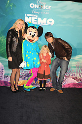 """DAN HIPGRAVE, his daughter HONEY (his daughter with Gail Porter) and his fiance LYNSEY HORN photographed with Minnie Mouse at a VIP Opening night of Disney & Pixar's """"Finding Nemo on Ice"""" at The O2 Arena Grennwich London on 23rd October 2008."""