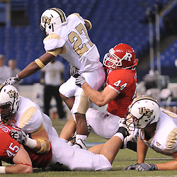 Dec 19, 2009; St. Petersburg, Fla., USA; Rutgers linebacker Ryan D'Imperio (44) tackles UCF running back Jonathan Davis (27) during NCAA Football action in Rutgers' 45-24 victory over Central Florida in the St. Petersburg Bowl at Tropicana Field.