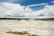 Tourists view geysers in Yellowstone National Park.  Wyoming, USA