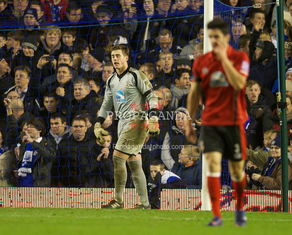 LIVERPOOL, ENGLAND - Saturday, January 7, 2012: Tamworth's goalkeeper Joe Collister looks dejected after Everton score the second goal during the FA Cup 3rd Round match at Goodison Park. (Pic by David Rawcliffe/Propaganda)