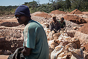 Miners rest after working in a mine waste area. Workers are seaching for left over cobalt near a mine between  Lubumbashi and Kolwezi, May 31, 2015. AFP PHOTO/FEDERICO SCOPPA