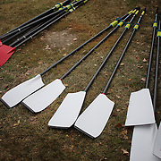 Oars stacked on the river bank during The 49th Head of the Charles Regatta on the Charles River which separates Boston and Cambridge, Massachusetts, USA. The Head of Charles began in 1965, is the worlds largest two day rowing event with over 9000 competitors from around the globe competing. The course is 3 miles (4,800 meters) long and stretches from the start at Boston University's DeWolfe Boathouse near the Charles River Basin, passing Harvard University to the finish just after the Eliot Bridge. Boston, Massachusetts, USA. 19th October 2013. Photo Tim Clayton