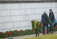 A young girls carries wreaths to be placed at graves during Wreaths Across America Saturday, December 14, 2019 at Washington Crossing National Cemetery in Newtown, Pennsylvania. Thousands of wreaths are laid each year for Wreaths Across America by volunteers who gather and then place the wreaths at graves of veterans. (Photo by William Thomas Cain / CAIN IMAGES)