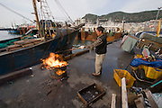 Jagalchi Fish Market. Man burning trash.