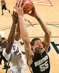 Wake Forest center Tony Woods (55) grabs a rebound from Virginia center Tunji Soroye (21).  The Virginia Cavaliers fell to the #13 ranked Wake Forest Demon Deacons 70-60 at the John Paul Jones Arena on the Grounds of the University of Virginia in Charlottesville, VA on February 28, 2009.