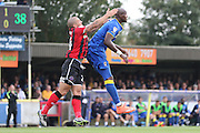 Shrewsbury Town FC defender Shrewsbury Town FC defender and captain Adam El-Abd with AFC Wimbledon striker Tom Elliott (9) during the EFL Sky Bet League 1 match between AFC Wimbledon and Shrewsbury Town at the Cherry Red Records Stadium, Kingston, England on 24 September 2016. Photo by Stuart Butcher.