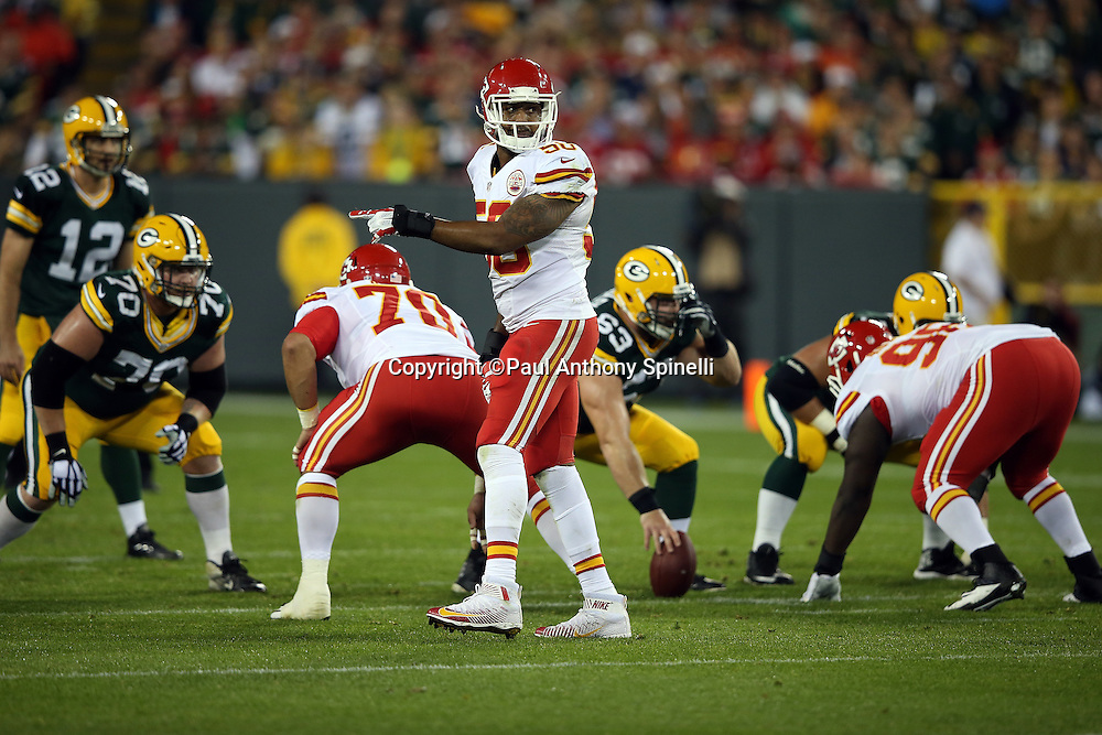 Kansas City Chiefs outside linebacker Justin Houston (50) points as he gets ready for the snap during the 2015 NFL week 3 regular season football game against the Green Bay Packers on Monday, Sept. 28, 2015 in Green Bay, Wis. The Packers won the game 38-28. (©Paul Anthony Spinelli)