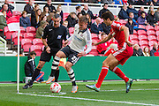 Fulham midfielder Lasse Vigen Christensen holds the ball from Middlesbrough FC defender George Friend during the Sky Bet Championship match between Middlesbrough and Fulham at the Riverside Stadium, Middlesbrough, England on 17 October 2015. Photo by George Ledger.