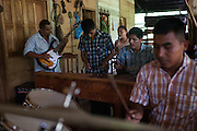 German Chub Choc (second from right), plays the marimba during a rehearsal for the music group Ecos con la Orquesta de Jesus, an Evangelical Christian group made up of family members in support of German. On September 27, 2009, German was shot during a botched eviction-turned-melee by Mynor Padilla, former head of security for the Guatemalan Nickel Company (CGN). After nearly losing his life, German recovered but now suffers from paraplegia. Numerous local Q'eqchi' Mayans were also injured or killed during the event, including former schoolteacher and local anti-mining leader Adolfo Ich Chaman. A criminal case against Padilla is underway in Guatemala for the shooting of Chub Choc and murder of Ich Chaman. Meanwhile, a landmark legal case against CGN parent company HudBay Minerals is underway in Canada. El Estor, Izabal, Guatemala. September 27, 2014.