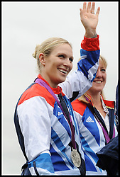 Zara Phillips waves to the crowd as she shows her London 2012 Olympic Silver medal at Burghley Horse Trials, Sunday September 2012. Photo By i-Images