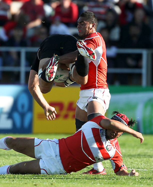 Canada's Jamie Cudmore is upended by Japans Sione Vatuvei in their Rugby World Cup pool match at McLean Park, Napier, New Zealand, Tuesday, September 27, 2011. Credit:SNPA / John Cowpland