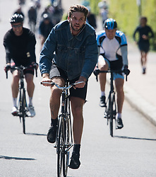 © Licensed to London News Pictures. 02/05/2020. London, UK. Cyclists exercise in Regents Park, London, during a pandemic outbreak of the COVID-19 strain of Coronavirus. According to government, the UK provided more than 122,000 coronavirus tests on the last day of April. Photo credit: Ben Cawthra/LNP
