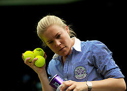 LONDON, ENGLAND - Monday, June 21, 2010: A line judge checks out the new balls during the Ladies' Singles 1st Round match on day one of the Wimbledon Lawn Tennis Championships at the All England Lawn Tennis and Croquet Club. (Pic by David Rawcliffe/Propaganda)