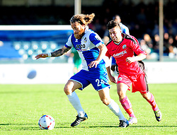 Bristol Rovers' Stuart Sinclair is challenged by Dover Athletic's Christian Nanetti - Photo mandatory by-line: Neil Brookman - Mobile: 07966 386802 - 04/10/2014 - SPORT - Football - Bristol - Memorial Stadium - Bristol Rovers v Dover - Vanarama Football Conference