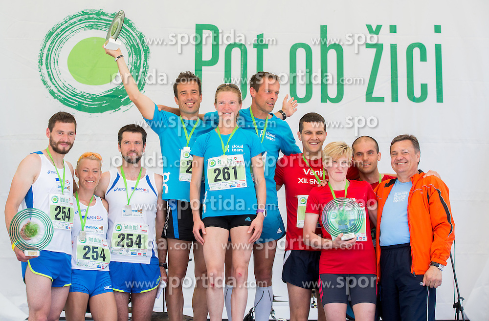 Winning men+ women teams at 29km race: Andrej Trojer, Aleksandra Fortin, Sandi Furlan, Primozic Lojze, Neza Mravlje, Mitja Mori, Vanja Butara, Marjeta Strzinar and Ivica Pedisic at trophy ceremony during running race Tek trojk et event Pot ob zici, on May 10, 2014, at Kongresni trg in Ljubljana, Slovenia. Photo by Vid Ponikvar / Sportida