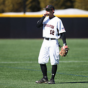 Michael Foster #12 of the Northeastern Huskies on the field during the game at Friedman Diamond on March 16, 2014 in Brookline, Massachusetts. (Photo by Elan Kawesch)