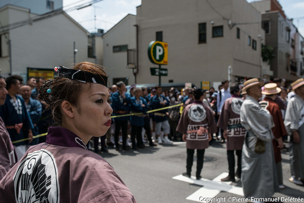 JAPAN, Tokyo : Local residents ensures the security during the Sanja Matsuri festival in Tokyo on May 15, 2016.<br />
