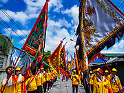 "02 JUNE 2017 - SAMUT SAKHON, THAILAND: The parade for the City Pillar Shrine in Samut Sakhon. The Chaopho Lak Mueang Procession (City Pillar Shrine Procession) is a religious festival that takes place in June in front of city hall in Samut Sakhon. The ""Chaopho Lak Mueang"" is  placed on a fishing boat and taken across the Tha Chin River from Talat Maha Chai to Tha Chalom in the area of Wat Suwannaram and then paraded through the community before returning to the temple in Samut Sakhon. Samut Sakhon is always known by its historic name of Mahachai.      PHOTO BY JACK KURTZ"