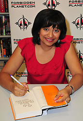 Nalini Singh book signing.  <br /> New Zealand born dark fantasy author Nalini Singh signs copies of her novel Heart of Obsidian, at Forbidden Planet, Shaftesbury Avenue,<br /> London, United Kingdom, 14 June 2013. Photo by Nils Jorgensen / i-Images.
