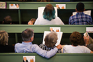 Participants listen during the Festival Dedication Service at the Town and Parish Church of St. Mary's before the dedication of The International Lutheran Center at the Old Latin School on Sunday, May 3, 2015, in Wittenberg, Germany. LCMS Communications/Erik M. Lunsford