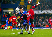 Fotball<br /> Foto: BPI/Digitalsport<br /> NORWAY ONLY<br /> <br /> Paris SG v Chelsea<br /> UEFA Champions League. Stamford Bridge, London. 24/11/2004.<br /> <br /> Modeste M'Bami of PSG takes a ride on the back of Chelsea's Damien Duff