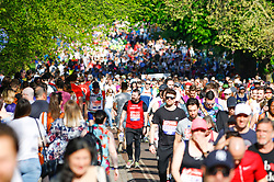© Licensed to London News Pictures. 22/04/2018. London, UK. Runners near the start of the 2018 London Marathon which is being run in unusually warm temperatures for April. This years event is being started by HRH Queen Elizabeth II. Photo credit: Tom Nicholson/LNP