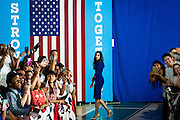 Huma Abedin, aidw to Hillary Clinton, presumptive 2016 Democratic presidential nominee, watches from the wings as her boss campaigns with Senator Tim Kaine (D-VA) at Northern Virginia Community College in Annandale, Va., U.S., on Thursday, July 14, 2016. Clinton and the former Virginia Governor discussed their shared commitment to building an America that is stronger together, while emphasizing that Donald Trump's divisive agenda would be dangerous for America. Kaine is considered to be the frontrunner for the Vice Presidential slot. Photographer: Pete Marovich/Bloomberg