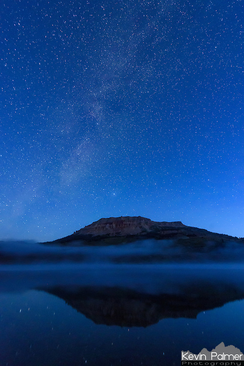 The deep blue colors of twilight overtake the sky as dawn approaches at Beartooth Lake.