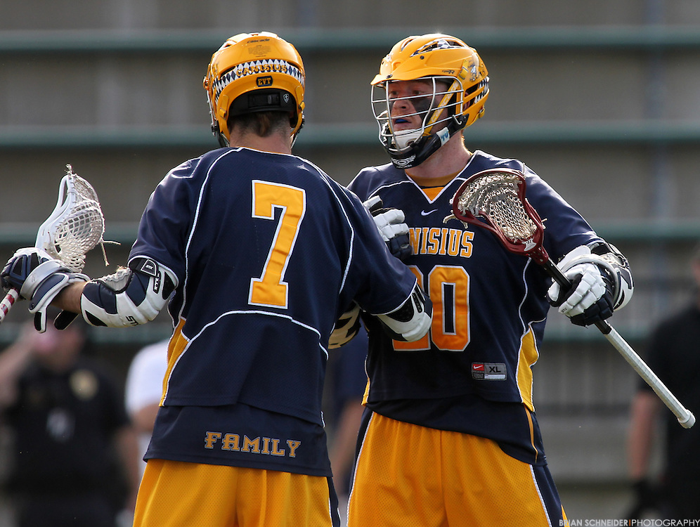 May 12, 2012; Baltimore, MD, USA; Canisius College Golden Griffins Brendan O'Hagan (7) and Traivs Gibbons (20) against Loyola Maryland Greyhounds at Ridley Athletic Complex in Baltimore, MD. Mandatory Credit: Brian Schneider-www.ebrianschneider.com