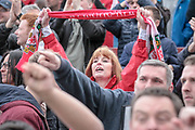 A Wrexham fan celebrates at full time as her team runs out 3-1 winners and take all three points from the Vanarama National League match between York City and Wrexham FC at Bootham Crescent, York, England on 17 April 2017. Photo by Mark P Doherty.