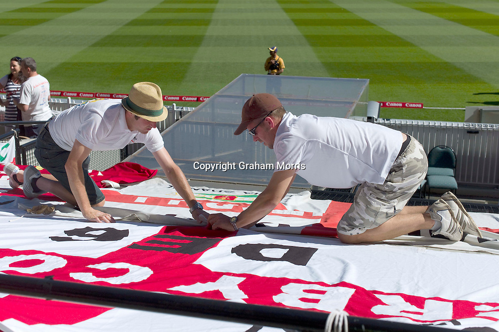 The Barmy Army secure their flags before play starts on the fourth day of the fourth Ashes test match between Australia and England at the MCG in Melbourne, Australia. Photo: Graham Morris (Tel: +44(0)20 8969 4192 Email: sales@cricketpix.com) 29/12/10