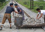 North Korean men working on railways in Hamhung, North Korea.