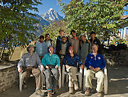 Trekkers at Lukla village in eastern Nepal, with the peak of Khumbila (or or Khumbi Yul Lha; 18,900 feet / 5761 meters) in the background. Because local Sherpa people traditionally consider Khumbila to be a sacred warrior spirit and guardian of the Khumbu District, Nepal has declared this mountain illegal to climb. For licensing options, please inquire.