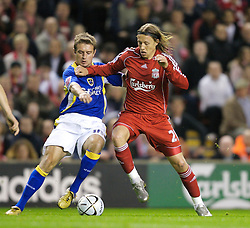 LIVERPOOL, ENGLAND - Wednesday, October 31, 2007: Liverpool's Lucas Levia and Cardiff City's Stephen McPhail during the League Cup 4th Round match at Anfield. (Photo by David Rawcliffe/Propaganda)