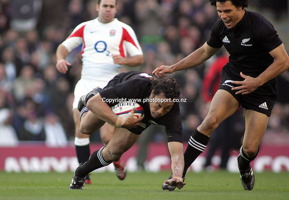 All Black captain Tana Umaga scores a try during the rugby union test match versus England at Twickenham, England, UK, Saturday 19 November 2005. The All Blacks defeated England 23-19. Photo: Kim Fraser/Photosport.