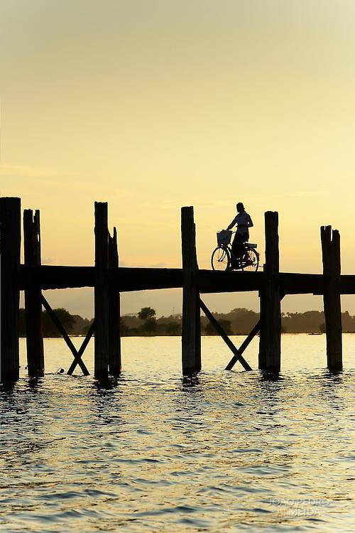 WOman atU Bein bridge by sunset