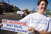 November 1, 2008  -- PHOENIX, AZ: REBECCA SCHNEIDER, from Mesa, AZ, pickets the front of Republican Presidential candidate and Arizona Senator John McCain's office Saturday. About 200 people attended an anti John McCain rally in Phoenix, a block from the Senator's Arizona office. The rally was organized by the Arizona End the War Coalition.   Photo by Jack Kurtz / ZUMA Press