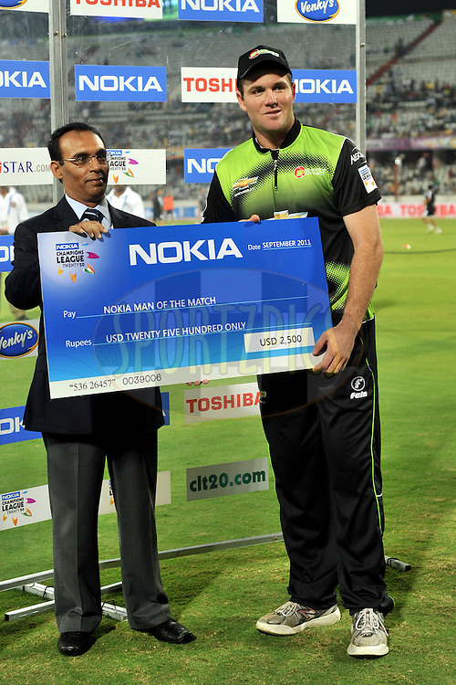 JJ Smuts of Warriors receives the man of the match award during the presentation after Match 4 of the NOKIA CLT20 between The Warriors and the South Australian Redbacks held at the Rajiv Gandhi International Stadium, Hyderabad on the 25th September 2011..Photo by Pal Pillai/BCCI/SPORTZPICS