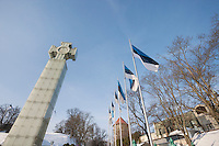 Low angle view of Freedom Monument and flagpoles; Tallinn; Estonia; Europe