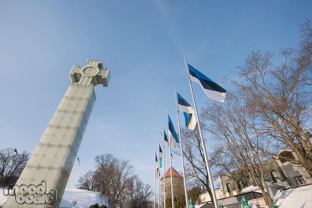 Low angle view of Freedom Monument and flagpoles; Tallinn; Estonia; Europe