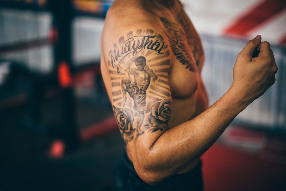 A trainer at Bangkok Fight Lab with a Muay Thai tattoo on his arm. Muay Thai, the national sport of Thailand, is a crucial part of MMA training as well.