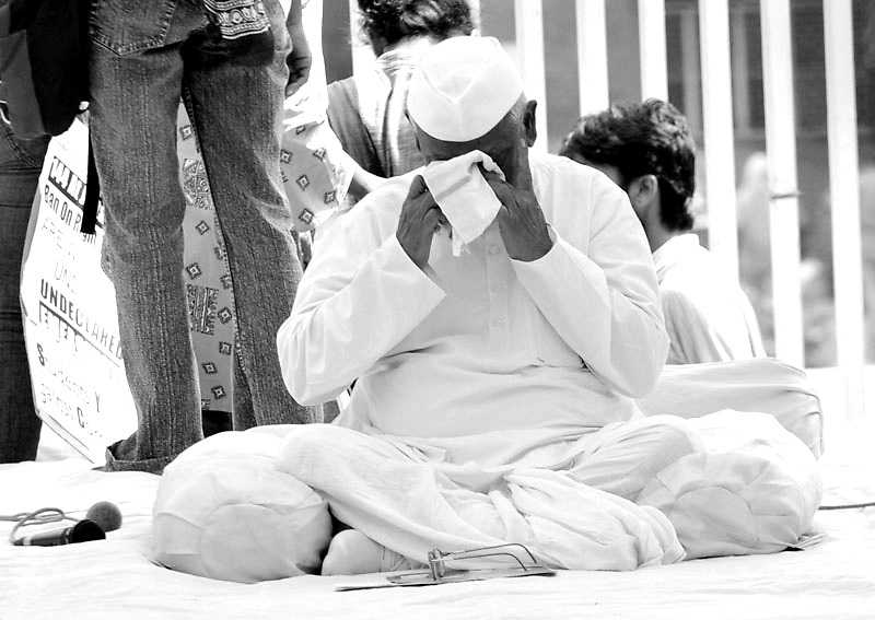 Social activit Anna Hazare on a day long hunger strike at the Rajghat (Mahatma Gandhi's funeral site) on the protest against the Indian government's eccess on public attending meeting called by Ramdev on 5th July 20111 at Delhi's Ramlila grounds.Photo by Shome Basu