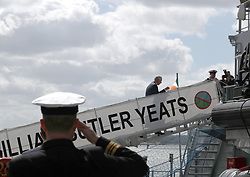 The Prince of Wales walks up a gangplank of a ship during a visit to the Naval Base, near Cork as part of his tour of the Republic of Ireland.