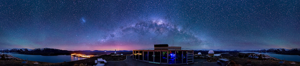 Panoramic view from Mt John with a faint aurora over Tekapo