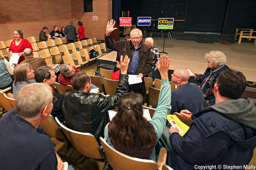Wayne Bryant, of Marion, helps lead the Marion 2-2 precinct at the 2010 Linn County Republican Caucus at Washington High School in Cedar Rapids on Saturday January 23, 2010. About 757 people attended the event. (Stephen Mally/Freelance)
