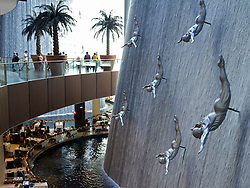 Sculptures in waterfall at Dubai Mall in Dubai in United Arab Emirates