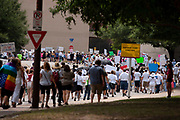Demonstrators return to Dallas City Hall after marching against the Trump administration 's policy of separating the children of immigrants from their parents after they have crossed the border into the US seeking asylum, and then sending them to camps in the desert in West Texas.