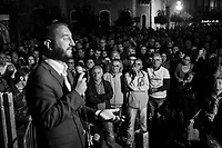 MILAZZO, ITALY - 27 OCTOBER 2017: Supporters listen to Five Star Movement (Italian: Movimento 5 Stelle, or M5S) candidate Giancarlo Cancelleri, running for governor of Sicily in the upcoming Sicilan regional election, during a rally here in Milazzo, Italy, on October 27th 2017.<br /> <br /> The Sicilian regional election for the renewal of the Sicilian Regional Assembly and the election of the President of Sicily will be held on 5th November 2017.